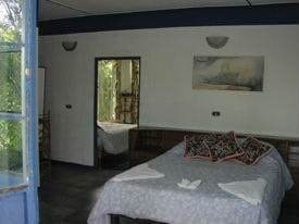 1/2 ACRE – 10 Room Boutique Hotel Plus 2 Bedroom Home In Great Location!!