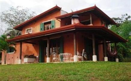 1.5 ACRES – Beautiful 2 Bedroom Home Built With Imported Antique Doors and Windows,