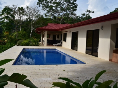 0.92 ACRES - 2 Bedroom Ocean View Home With Pool Located In Lagunas!!