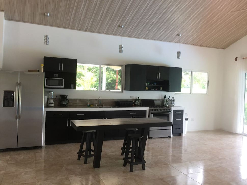 0.23 ACRES - 2 Bedroom Home With Pool With Central Uvita Location!!