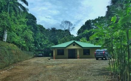 0.74 ACRES – 3 Bedroom Home + 2 Cabins + BBQ Lounge +Fish Pond+ 1 Minute From Main Road
