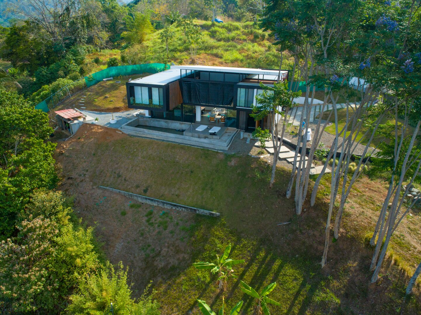 Modern Shipping Container Home 0.64 acres - 3 bedroom modern ocean view home built with