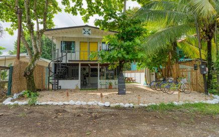 0.06 ACRES – 6 Room Hostel Plus Owner's Apartment Walking Distance To Beach!!!!
